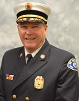 Headshot photo of Chief Benson