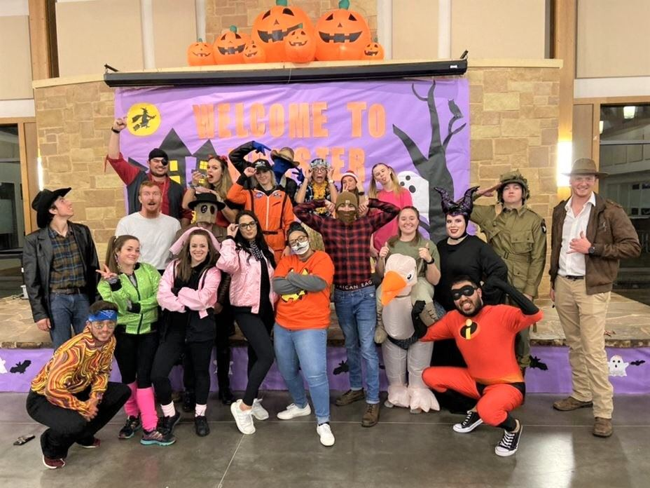 Staff Pose for a Picture during the 2019 Monster Mash Event