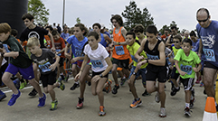 Athletes running at TWFG Muddy Trails Bash