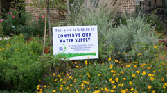 Water-Wise Village Challenge Sign in Flower Bed